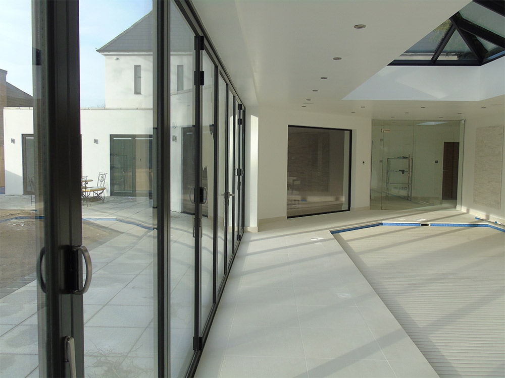 Bifolding doors 1st folding sliding doors for Retractable sliding door