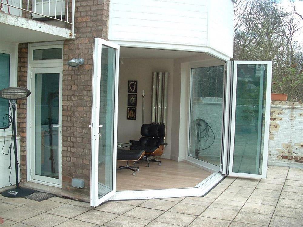 Sunflex make doors to go around 90 and 135 degree frameless corner post. & Sunflex · 1st Folding Sliding Doors