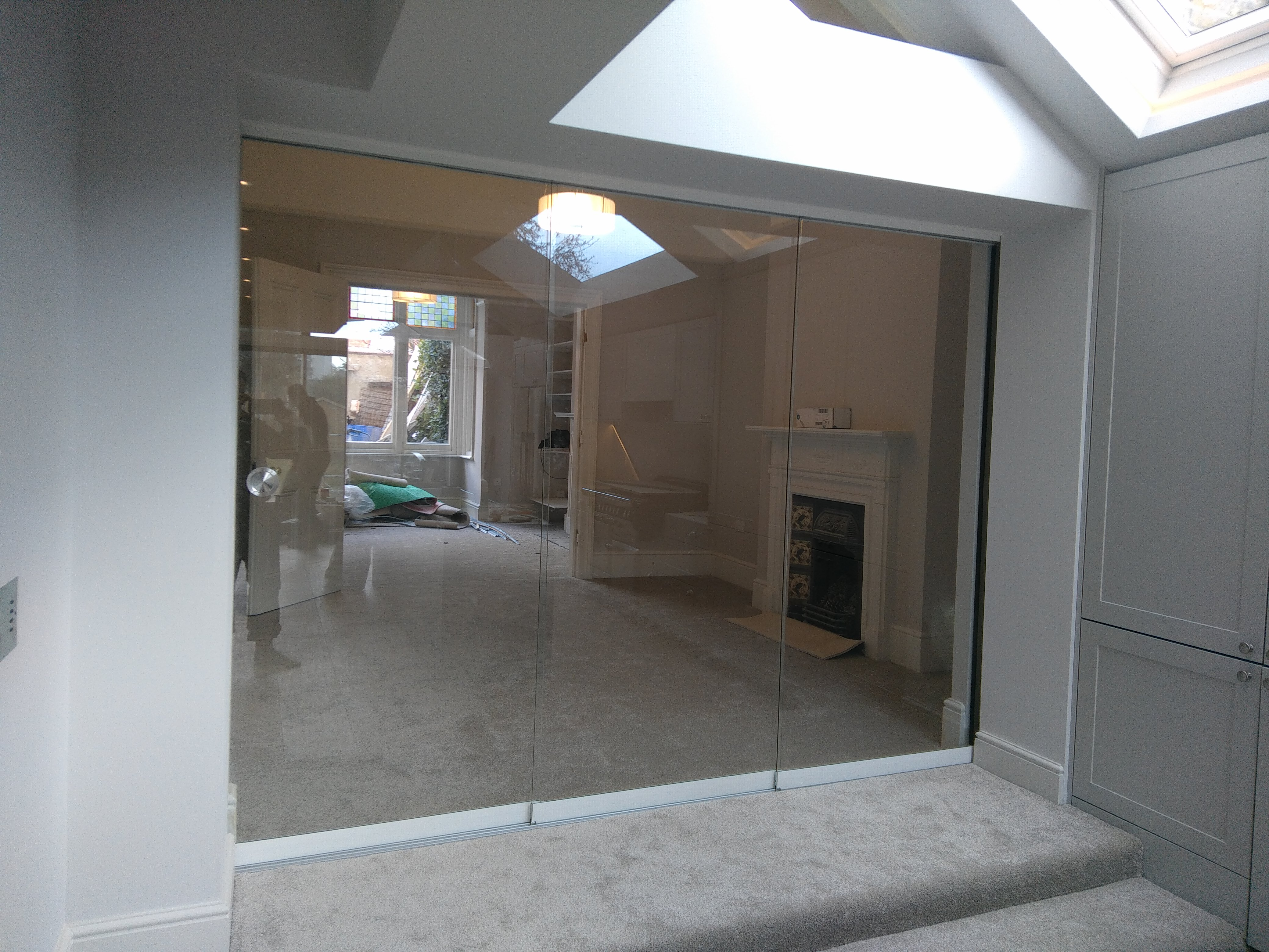 Sunflex SF20 virtually frameless internal sliding Door with 8mm clear toughened glass giving that seamless look. To get this finish; plastering and ... & Sunflex · 1st Folding Sliding Doors