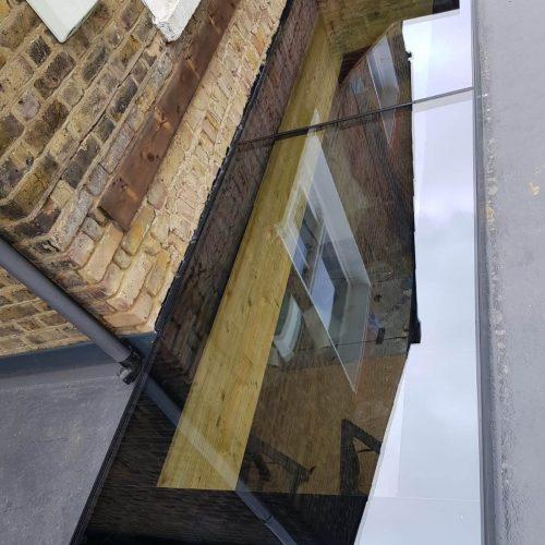 Lightwells, skylight, frameless glass