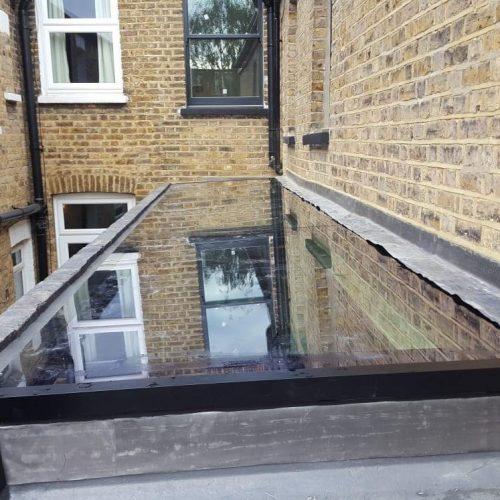 Virtually frameless glass skylight - 1st folding Sliding Doors