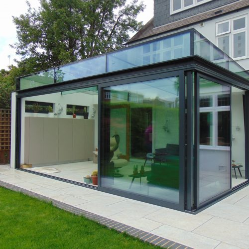 Frameless Glass Conservatory - 1st Folding Sliding Doors