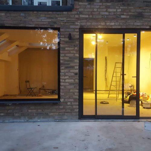 Frameless glass window seat - 1st Folding Sliding Doors