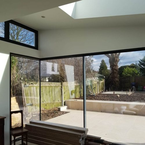 Frameless glass corner - 1st Folding Sliding Doors