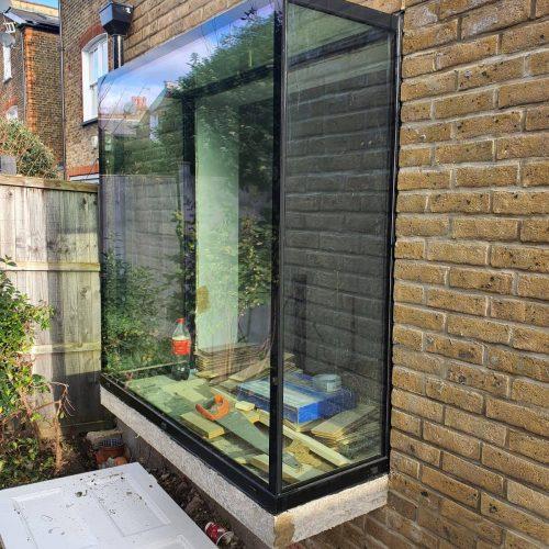 11st Folding Sliding Doors - glass window box seat